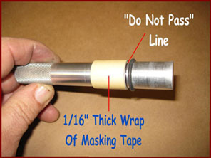 Masking taped do not pass line on stinger missile rocket rammer