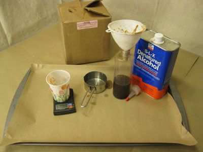 Supplies for dissolving red gum in denatured alcohol.