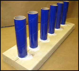 Multiple mortar tubes on one wooden base