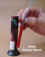 Electric match carefully being inserted into quickmatch