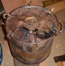Lid secured on charcoal making stock pot