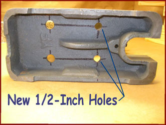 new holes drilled in arbor press base viewed from the bottom