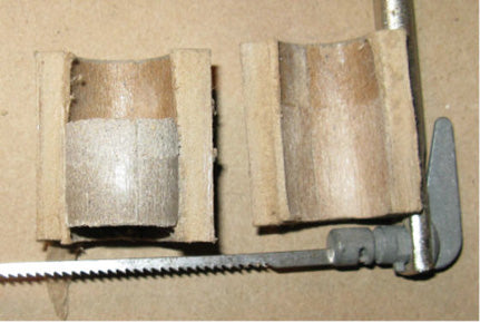 Cutaway Paper Tube Showing Locked-In Clay Bulkhead