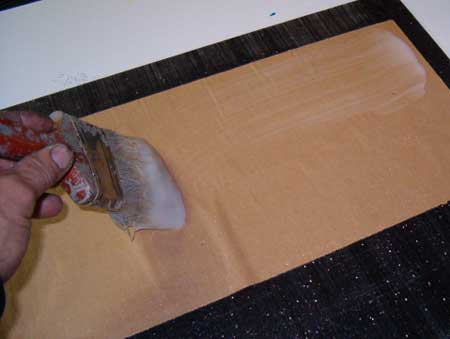Applying Wheat Paste to Kraft Paper Using a Paintbrush