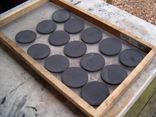 Black Powder Pucks on Drying Screen