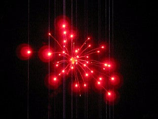 Red firework stars made with red gum black powder.