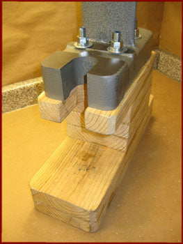 arbor press bolted to homemade wooden base
