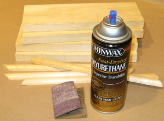 Sand All Wood Surfaces, and Apply Two Coats of Spray Polyurethane