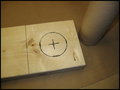 Wood base marked with tube circumference