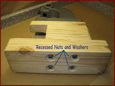 Recessed nuts in the bottom of a homemade wooden arbor press base