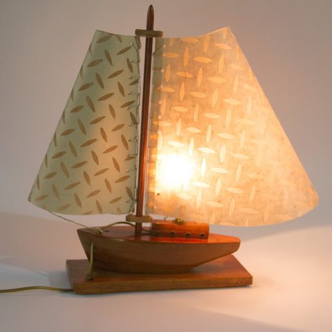 We made the sails on this model boat lamp and even did the sewn rigging