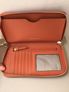Michael Kors orange leather tech wallet/wristlet - My Girlfriend's Wardrobe York Pa