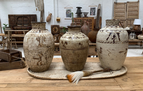 Handmade Chinese antique wine jars. Hand painted with traditional designs dated around 200 years ago.