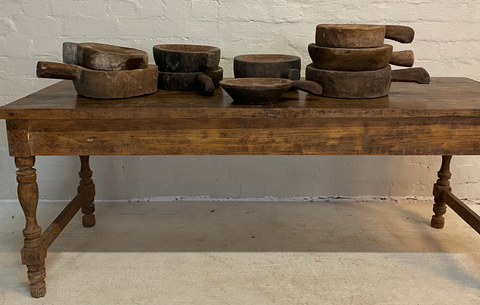 The best vintage tables for your holiday celebrations. Vintage table holding vintage pans and bowls.