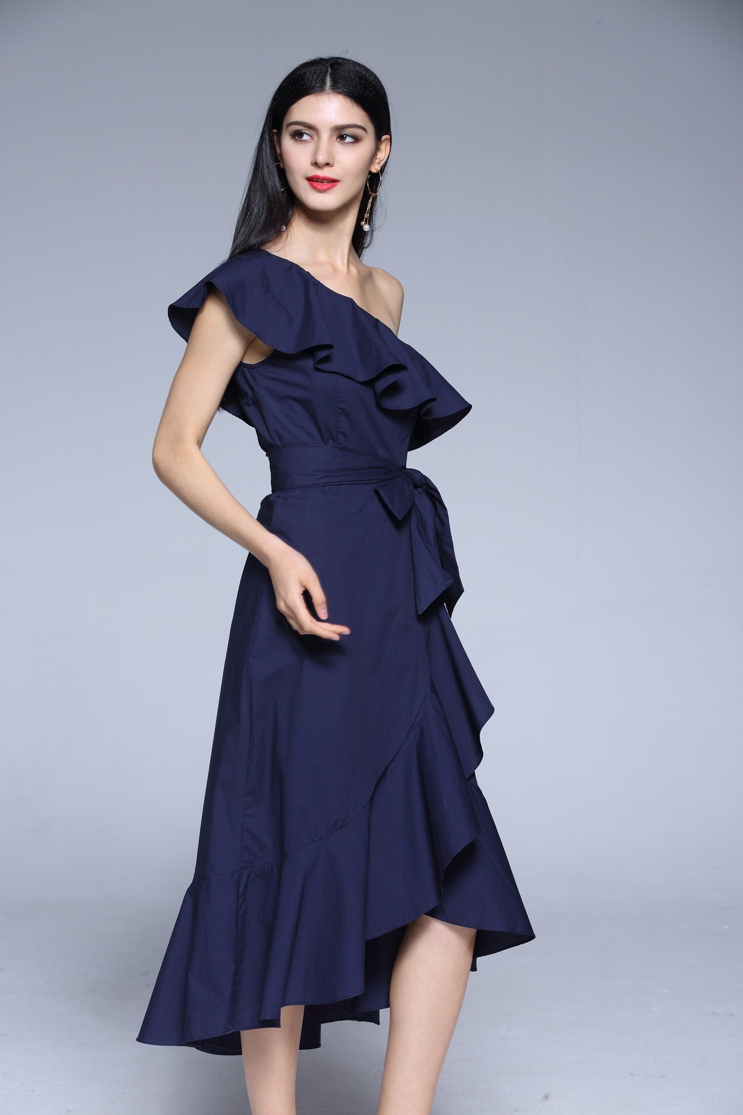 Worthier Asymmetrical Ruffle Midi Dress with Bow Tie detail in Navy