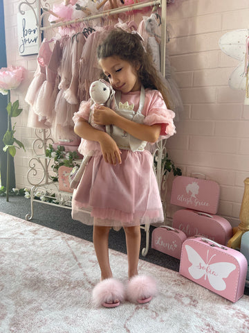 Girl with dolls