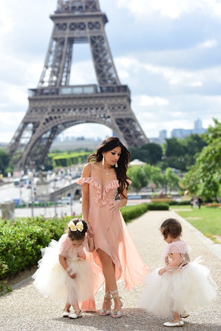 mother and daughters with Eiffel Tower in the background