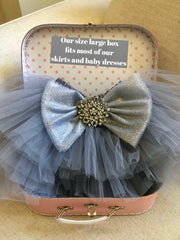 Size large box open with a gray glitter bow tutu placed inside
