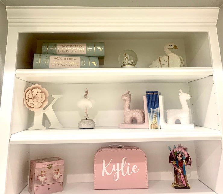 size large box placed on a white bookcase as decor