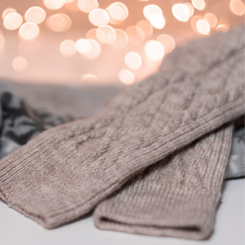 A taupe pair of knitted socks.