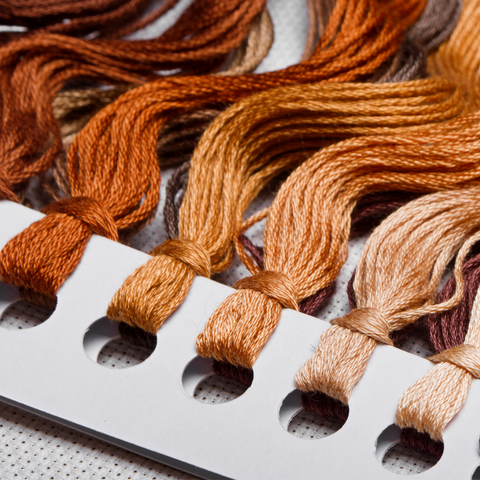 Color card for embroidery floss in warm browns.