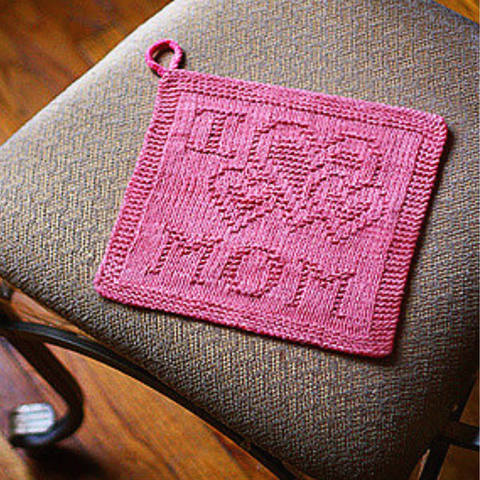 """Pink washcloth with """"I (heart shapes) mom"""" on it."""
