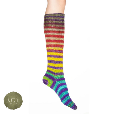 A rainbow striped sock fading from red near the knee to blue near the toe.