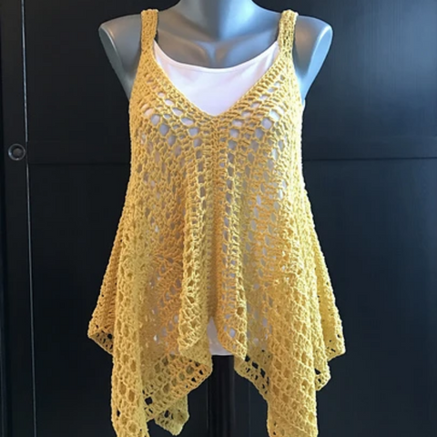 Yellow crocheted lace kerchief tank top over a solid white tank.