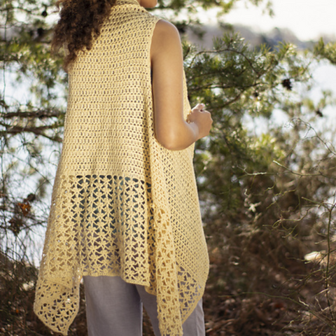 Yellow crocheted vest with a lace panel at the bottom.