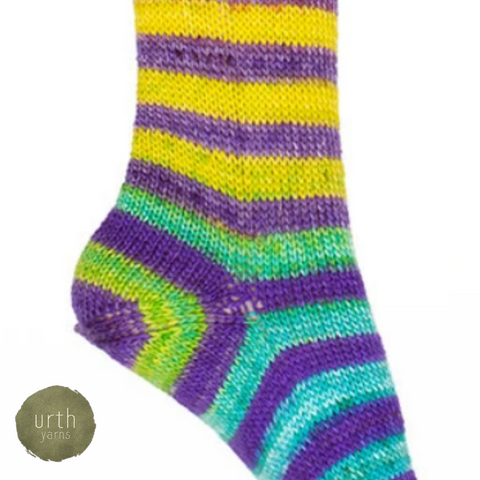 Heel of a striped sock with yellow fading to blue and purple stripes.