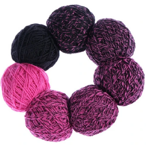 Ring of small balls of yarn in bright pink fading to dark purple.