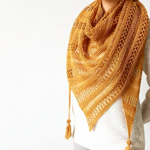 Yellow knit lace shawl with tassels.