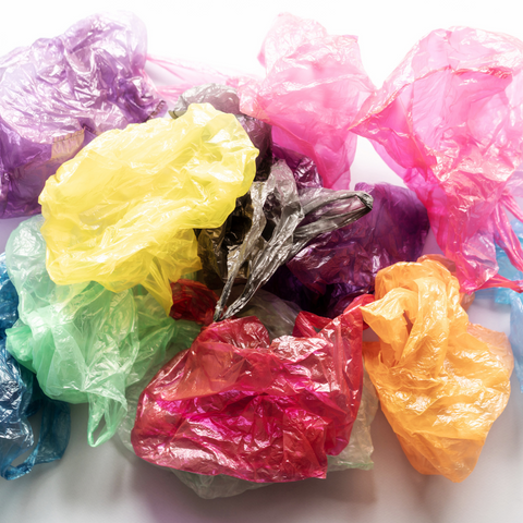 Pile of crinkled, multi-colored plastic bags.