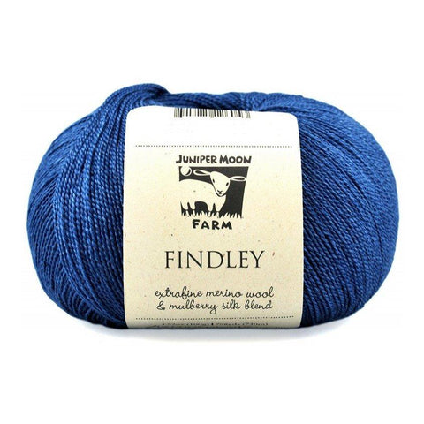 Ball of Juniper Moon Farms Findley yarn in a blue color.