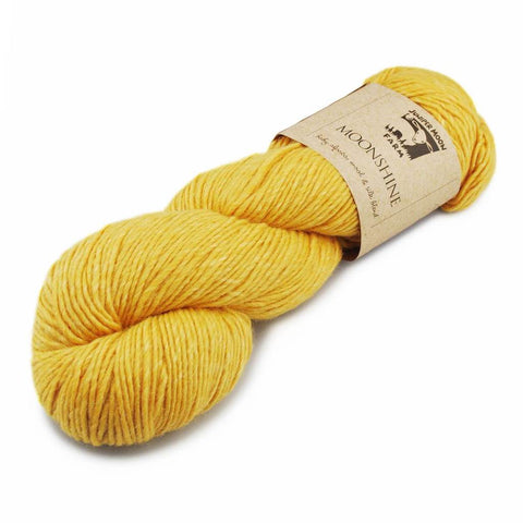 Skein of Juniper Moon Farm Moonshine in a yellow color.