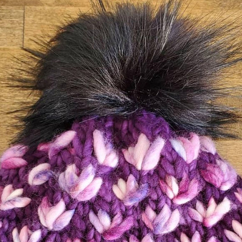 Image of the Lotus Flower Beanie Project by BKnitsHandmade. This hat is made with Malabrigo Rasta yarn in the colors purple and pink.
