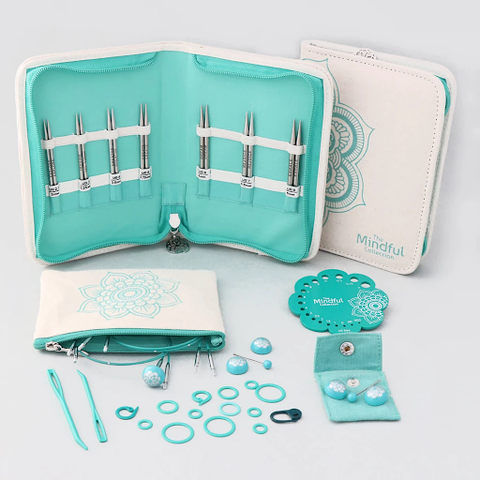 """The Knitter's Pride Mindful Collection's 5"""" Interchangeable Lace Needle Kindness Set brings together 7 of the most popular sizes, along with 4 smart cords and accessories. The assortment comes in a handy fabric case with a detachable multi-use pouch."""
