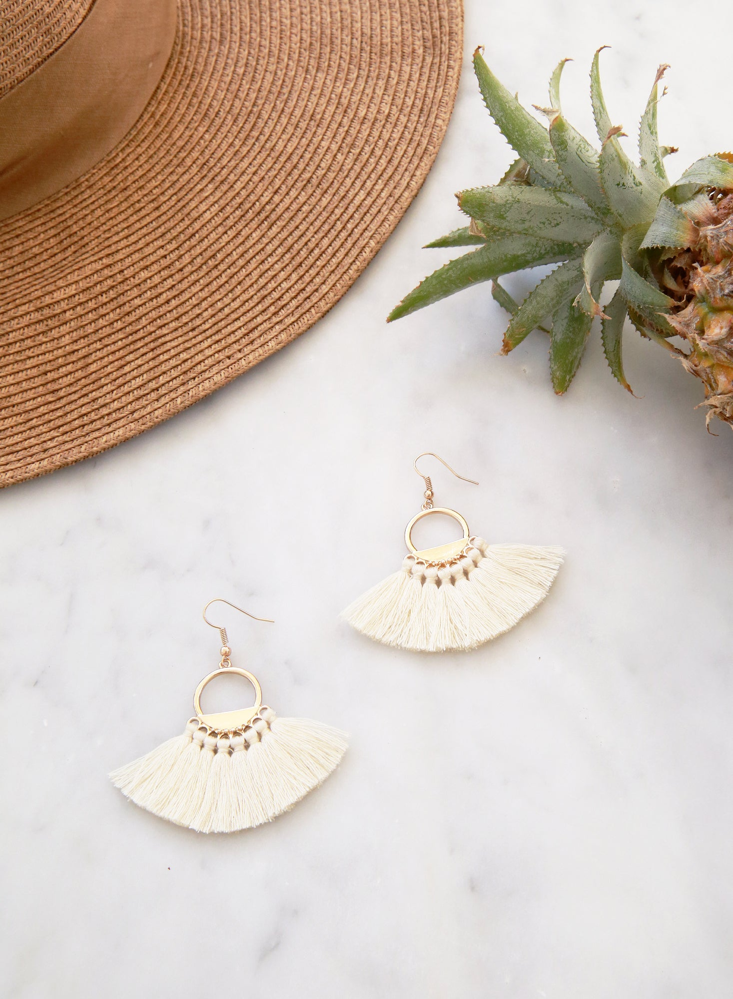 Jain Fan Tassels Earrings (Cream) at $18.00 only sold at And Well Dressed Online Fashion Store Singapore