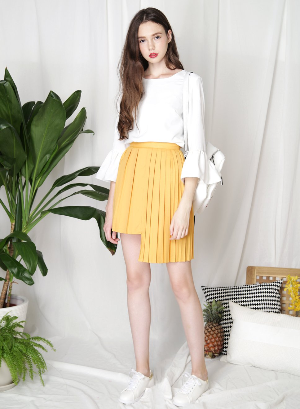 CRUSADE Uneven Hem Pleated Skirt (Marigold) - And Well Dressed