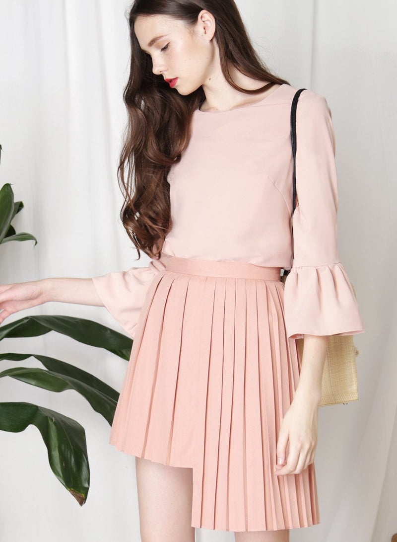 CRUSADE Uneven Hem Pleated Skirt (Peach Rose) at $ 25.50 only sold at And Well Dressed Online Fashion Store Singapore