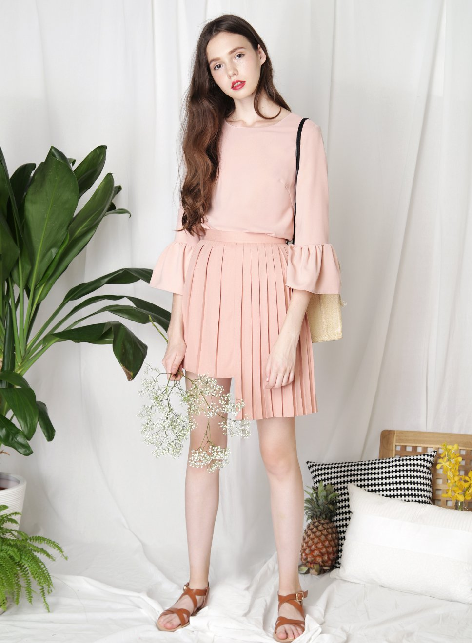 CRUSADE Uneven Hem Pleated Skirt (Peach Rose) at $ 34.50 only sold at And Well Dressed Online Fashion Store Singapore