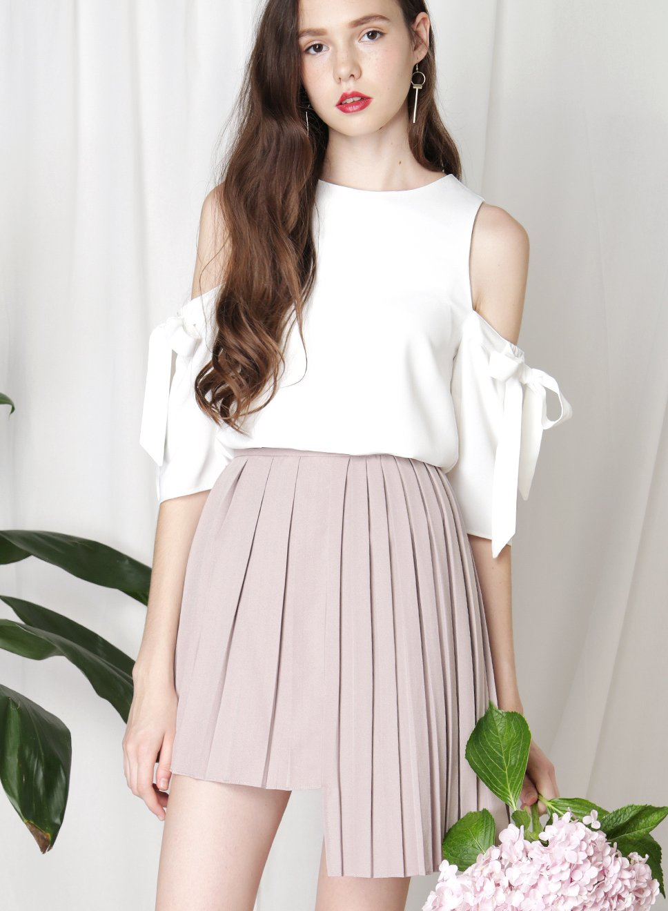 CRUSADE Uneven Hem Pleated Skirt (Taupe) at $34.50 only sold at And Well Dressed Online Fashion Store Singapore