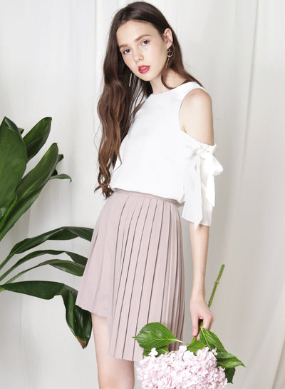 CRUSADE Uneven Hem Pleated Skirt (Taupe) at $ 34.50 only sold at And Well Dressed Online Fashion Store Singapore
