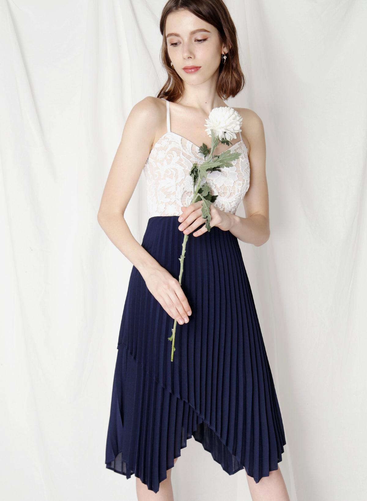 Finesse Uneven Pleats Dress (Navy) at $ 44.50 only sold at And Well Dressed Online Fashion Store Singapore