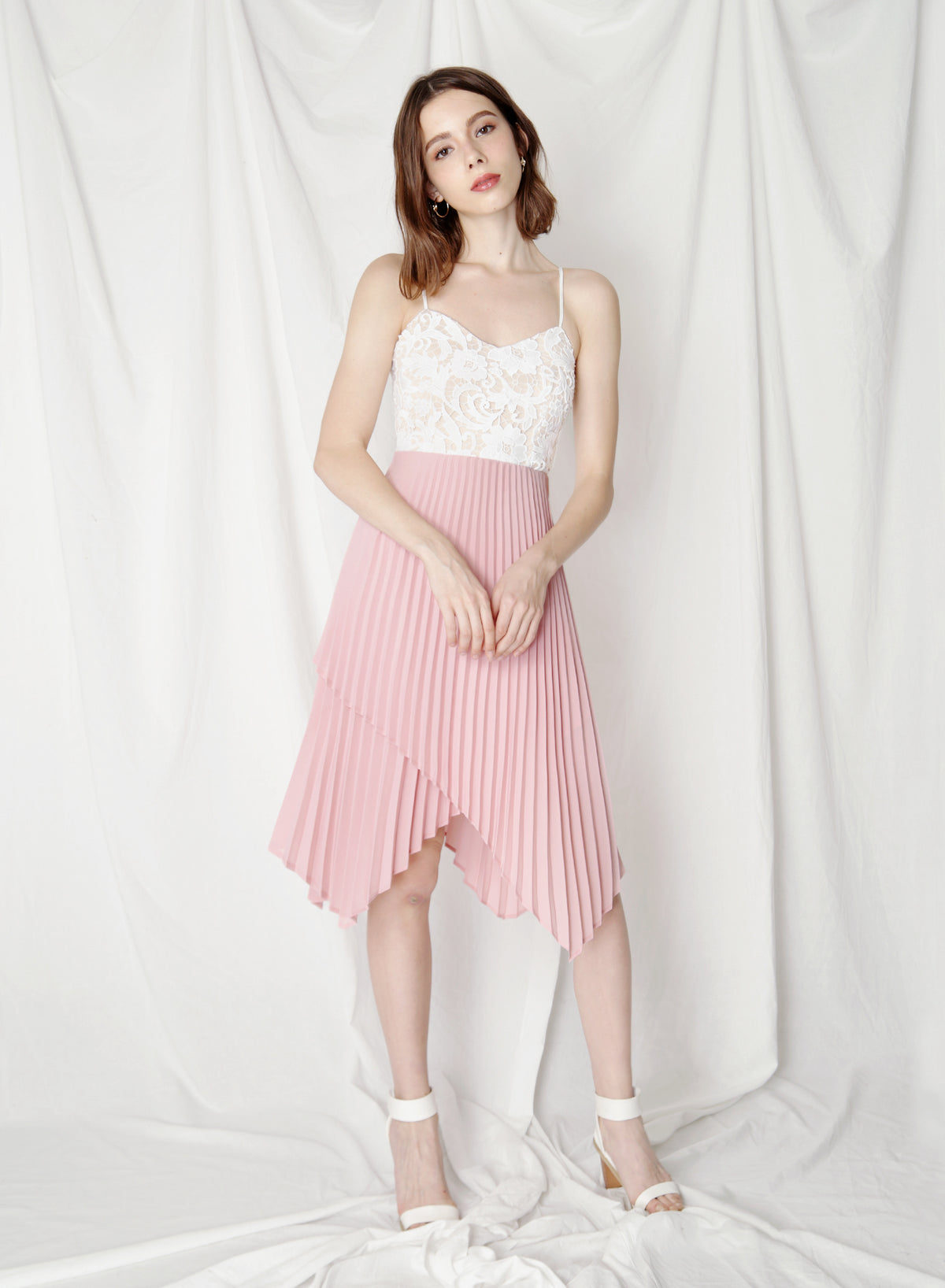 Finesse Uneven Pleats Dress (Blush) at $ 44.50 only sold at And Well Dressed Online Fashion Store Singapore