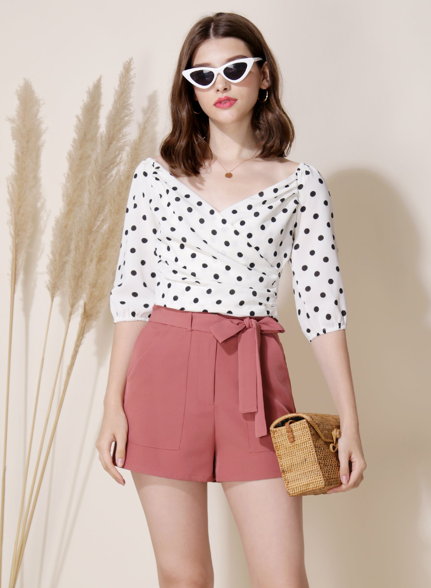 Amour Polka Dot Wrap Top (White) at $ 35.50 only sold at And Well Dressed Online Fashion Store Singapore
