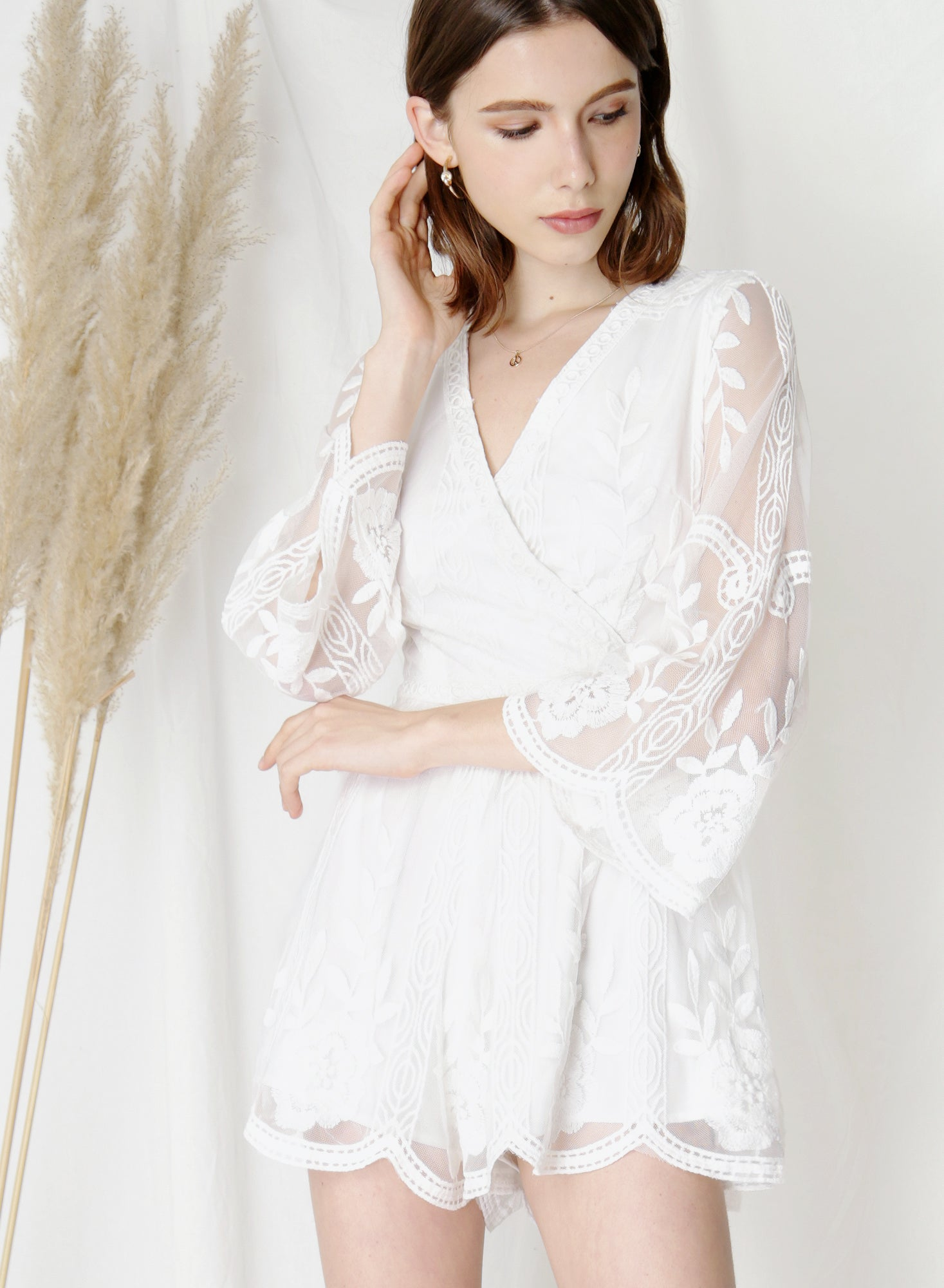 Blossom Flared Sleeves Lace Romper (White) at $43.50 only sold at And Well Dressed Online Fashion Store Singapore