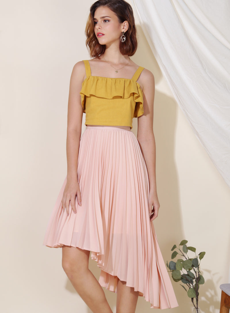 Faith Asymmetric Pleats Skirt (Blush) at $ 27.00 only sold at And Well Dressed Online Fashion Store Singapore