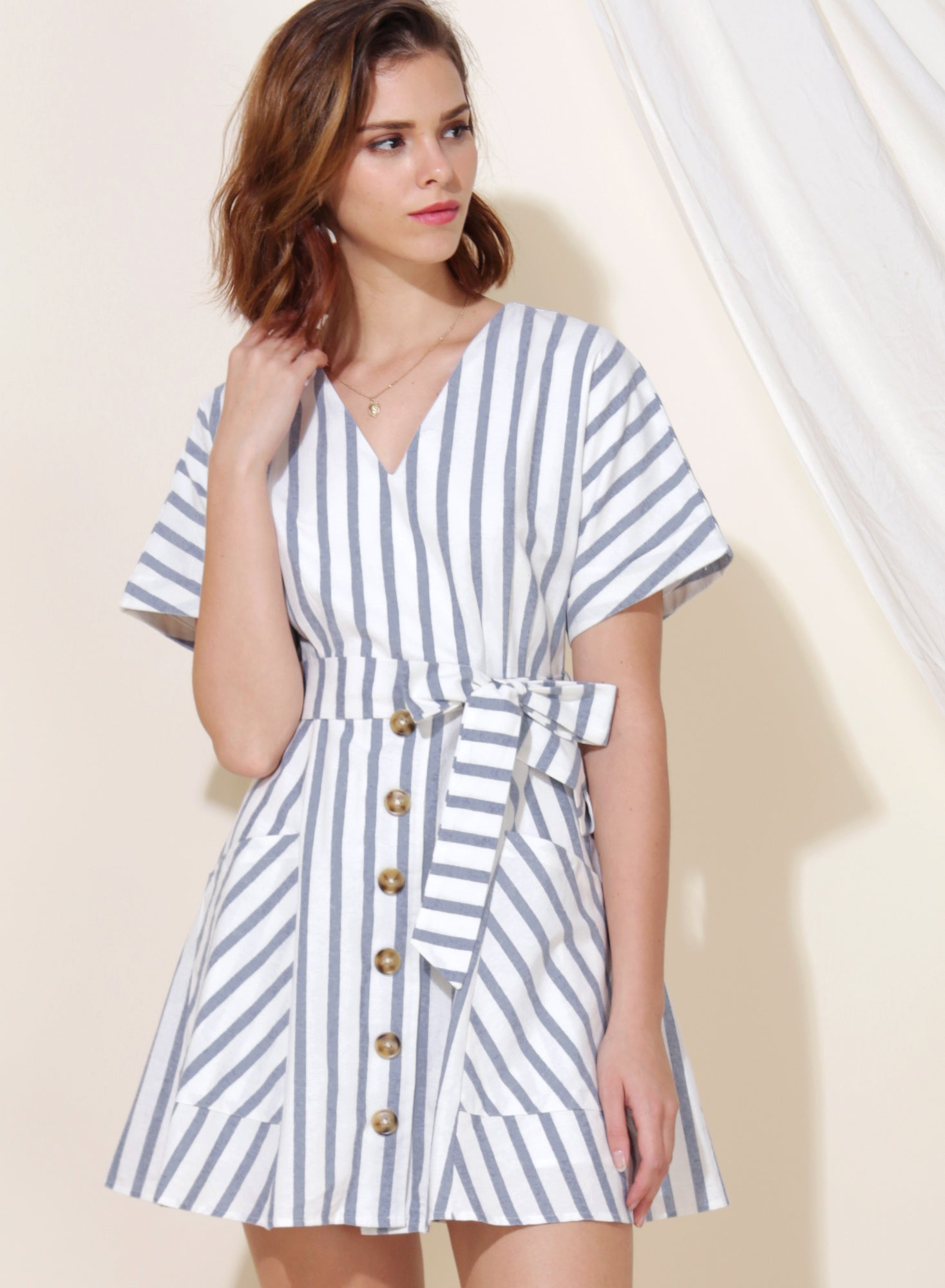 Perpetual Striped Flare Dress (Navy) at $ 43.50 only sold at And Well Dressed Online Fashion Store Singapore