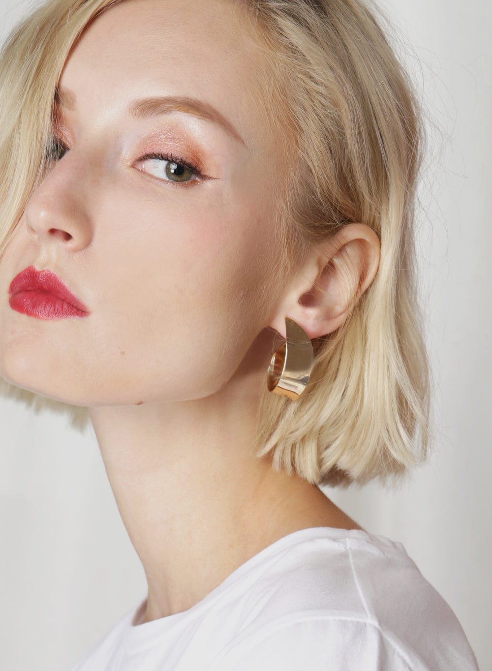 ETTA Half Hoop Earrings (Gold) at $ 18.00 only sold at And Well Dressed Online Fashion Store Singapore